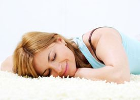 Woman napping on carpet